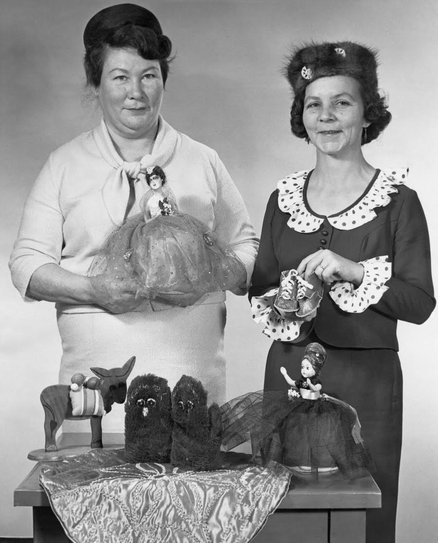 Courtesy of Glenbow Archives. No: PA-1599-161-3. Canadian Métis Club members Mrs. Ernest Smith and Mrs. J. B. MacLeod display handicrafts, Calgary, Alberta, [ca. December 9, 1968]
