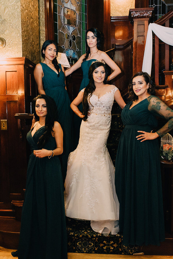 bridesmaids posing on stairway vertical