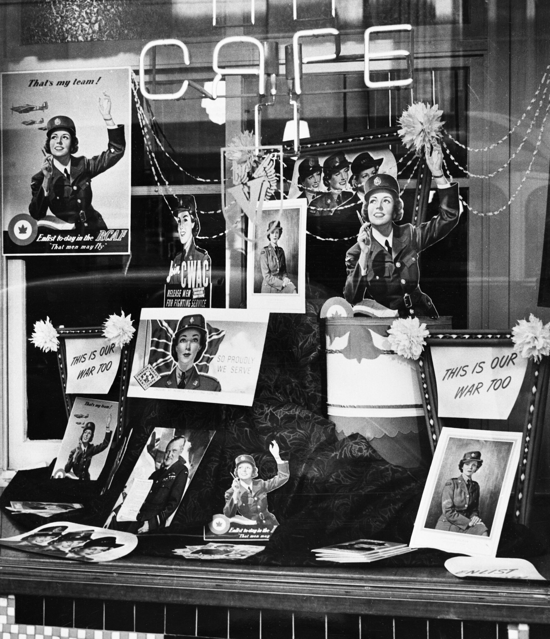 Black and white image of window display advertising enrolment in the Canadian Women's Army Corps, circa