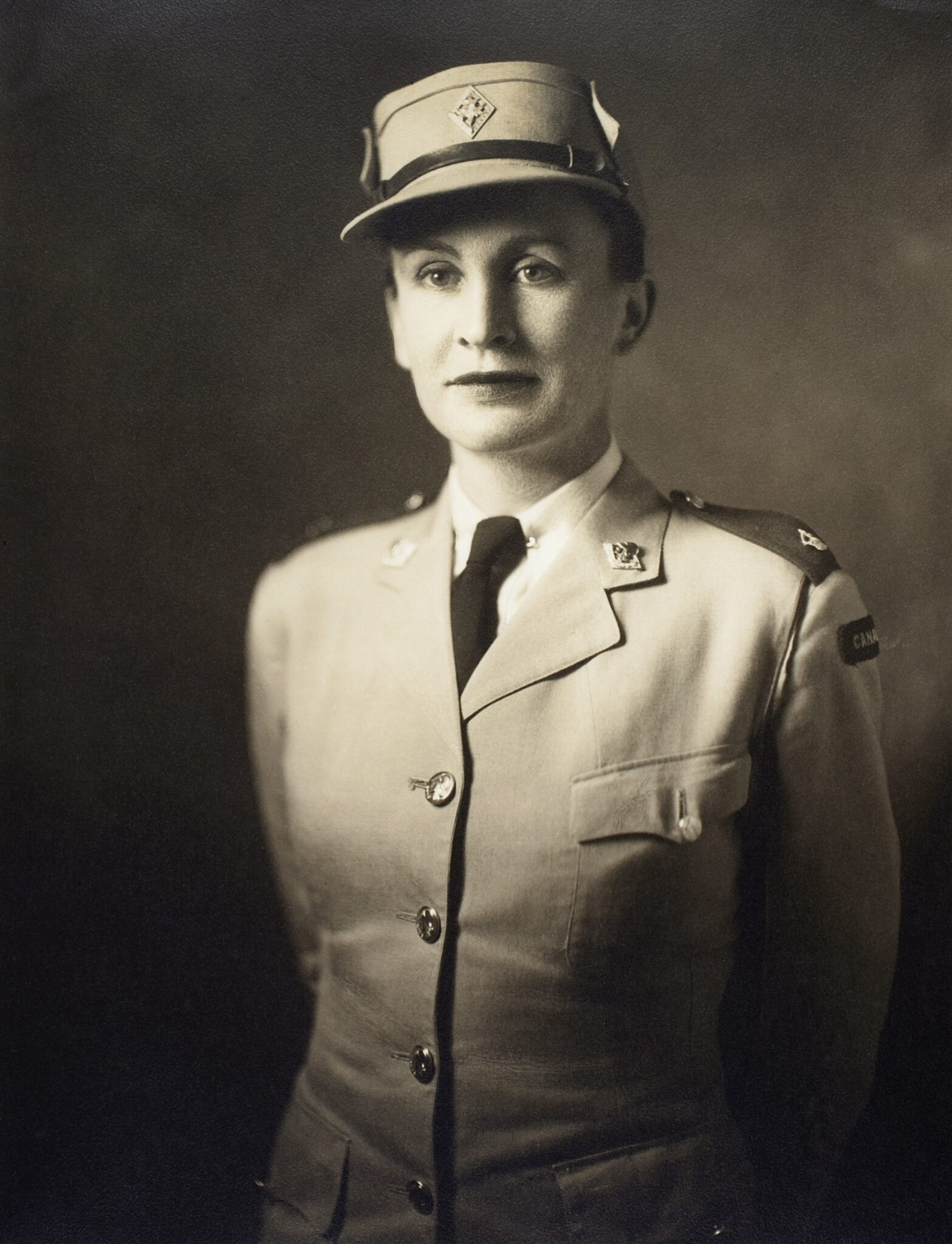 Black and white portrait image of woman in military uniform,1948