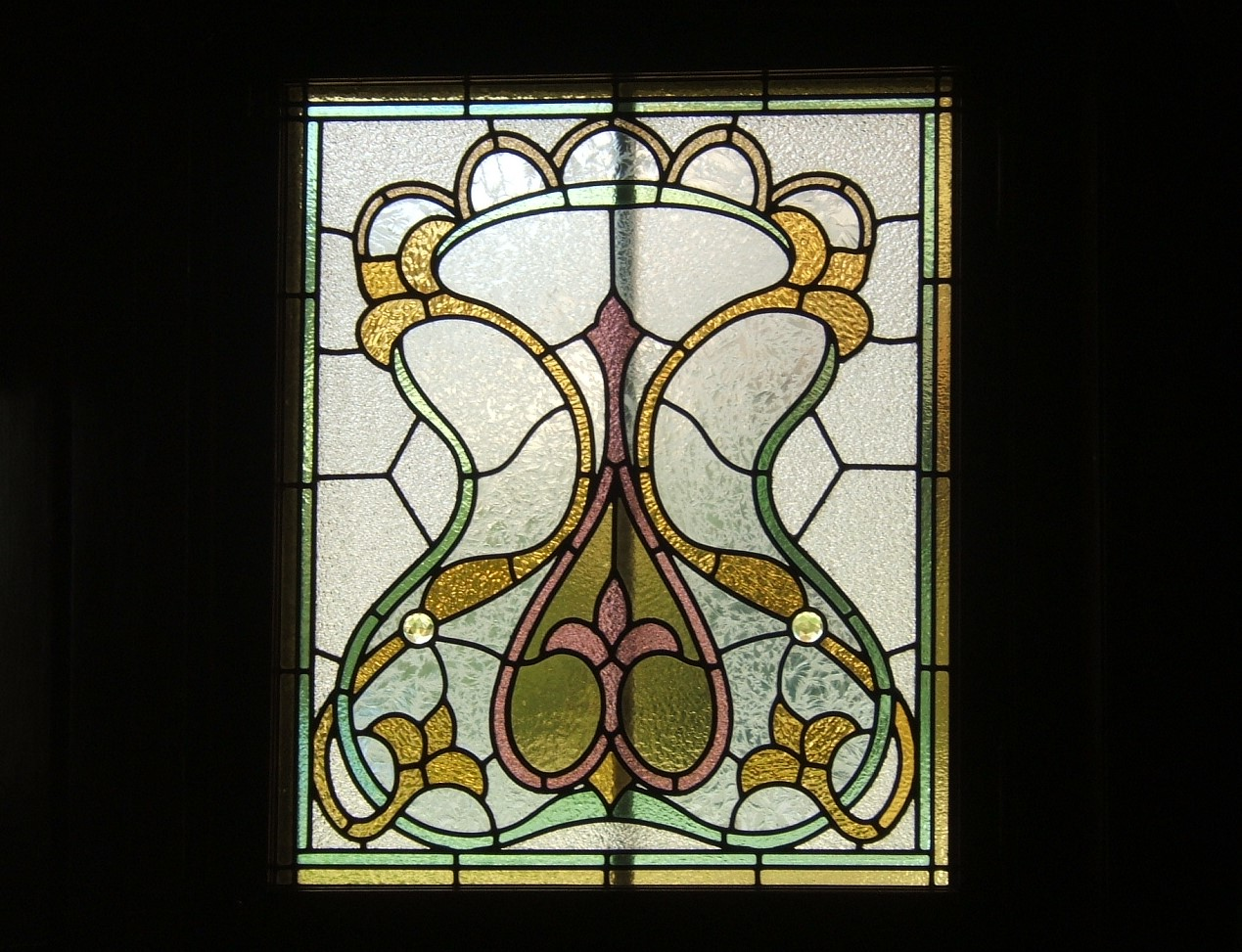 Yellow, red, green, and white stained glass window