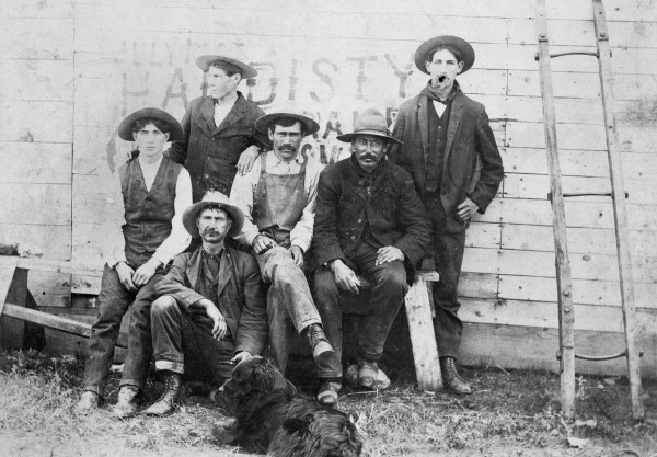 Black and white image circa 1910 of group of construction workers outside in Hardisty, Alberta